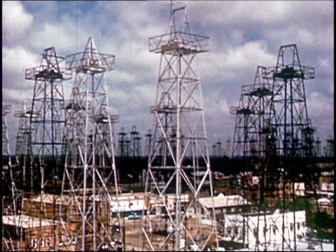1963 high angle wide shot distillation towers in texas oil field/ audio - prelinger archive stock videos & royalty-free footage