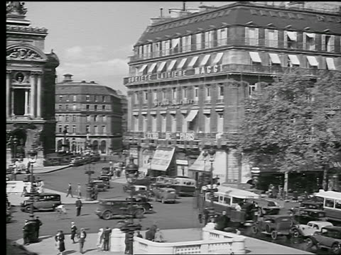b/w 1936 high angle wide shot pan from traffic in place de l'opera to l'opera garnier / paris, france - place de l'opera stock videos and b-roll footage