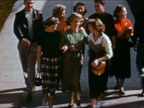 1953 high angle wide shot group of smiling high school students walking arm-in-arm / walking up steps - arm in arm stock videos & royalty-free footage
