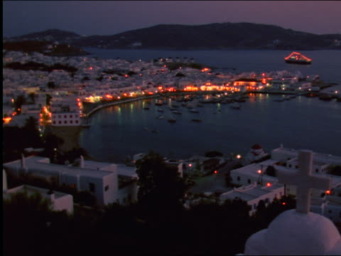 high angle wide shot harbor + coastal town at night / mykonos, greece - mykonos stock videos and b-roll footage