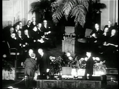 b/w 1949 high angle wide shot harry s truman shaking hands with men at signing of nato pact at united nations / doc - nato stock videos & royalty-free footage