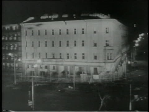 b/w 1967 high angle wide shot hotel building imploding at night - imploding stock videos and b-roll footage
