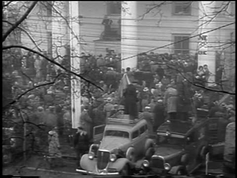 b/w 1935 high angle wide shot huge crowd gathered at federal courthouse / lindbergh kidnapping / flemington nj - 1935 stock videos and b-roll footage