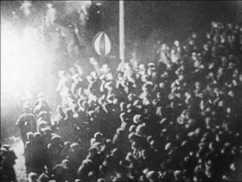 b/w 1927 high angle wide shot huge crowd rushing to greet lindbergh at le bourget airfield / paris / newsreel - 1927年点の映像素材/bロール