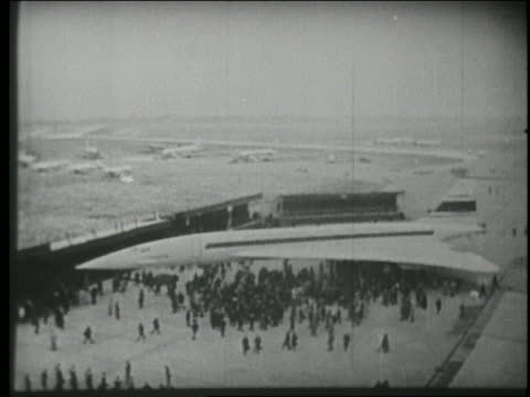 b/w 1969 high angle wide shot huge crowd walking underneath first concorde plane in france - british aerospace concorde stock videos & royalty-free footage