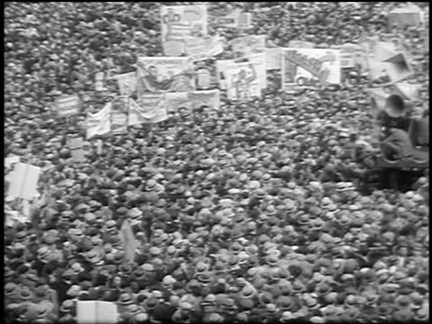 vídeos de stock e filmes b-roll de b/w 1933 high angle wide shot huge crowd with signs at communist demonstraton / union square nyc - 1933