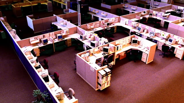 overexposed high angle wide shot pan large empty open office with cubicles - office partition stock videos & royalty-free footage