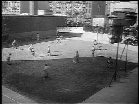 b/w 1941 high angle wide shot little league baseball game / nyc / newsreel - baseball diamond stock videos & royalty-free footage