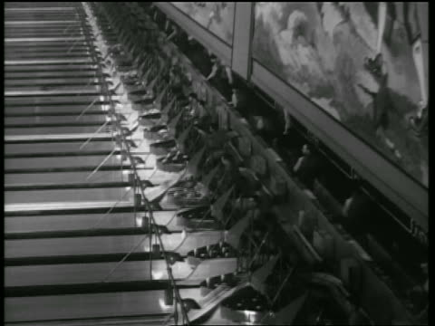 vídeos de stock, filmes e b-roll de b/w 1938 high angle wide shot men setting up pins in lanes of bowling alley / chicago / newsreel - cancha de jogo de boliche