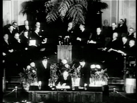 b/w 1949 high angle wide shot nato pact being signed at united nations / documentary - 1949 stock videos & royalty-free footage
