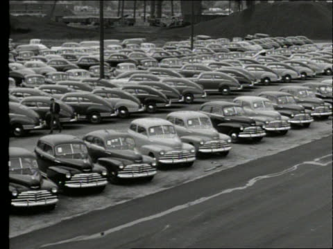 b/w 1948 high angle wide shot pan of new cars in parking lot - londonalight stock videos and b-roll footage