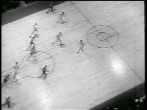 b/w 1946 high angle wide shot ny knicks moving towards basket in game with toronto huskies - 1946 stock videos and b-roll footage