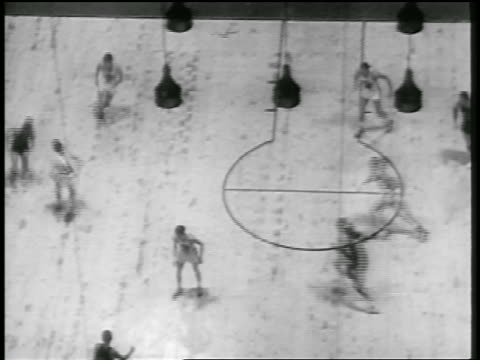 b/w 1946 high angle wide shot ny knicks scoring basket in game with toronto huskies / toronto - 1946 stock videos and b-roll footage