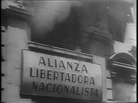 high angle wide shot of buenos aires streets full of people / low angle shot of military officials standing on a balcony and pan and tilt back to... - nazism video stock e b–roll