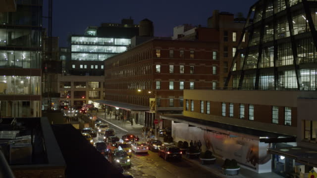 High angle wide shot of buildings and city street / New York, New York, United States