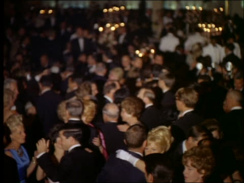 1965 high angle wide shot of crowd of couples in formalwear dancing / Academy Awards