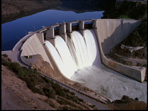 high angle wide shot of dam with flowing water / votorantin, sao paulo, brazil - dam stock videos & royalty-free footage