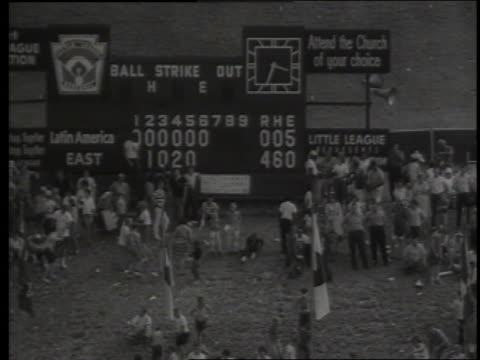b/w high angle wide shot of little league baseball scoreboard / 1964 little league world series / sound - scoreboard stock videos & royalty-free footage