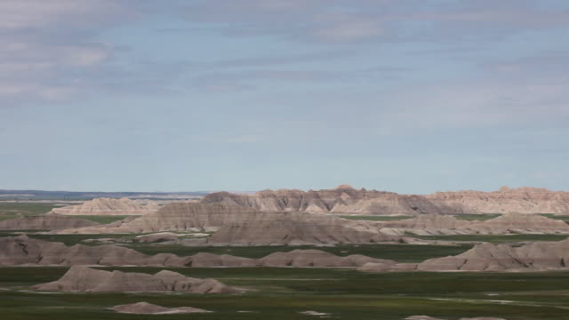 high angle wide shot of mountains in badlands national park - badlands national park stock videos & royalty-free footage