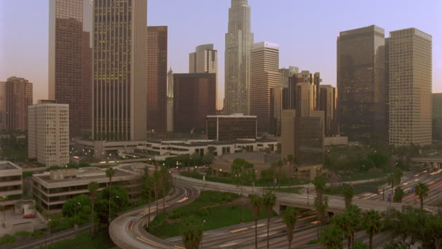 high angle wide shot of time lapse traffic and city day to night / los angeles - wide shot stock videos & royalty-free footage