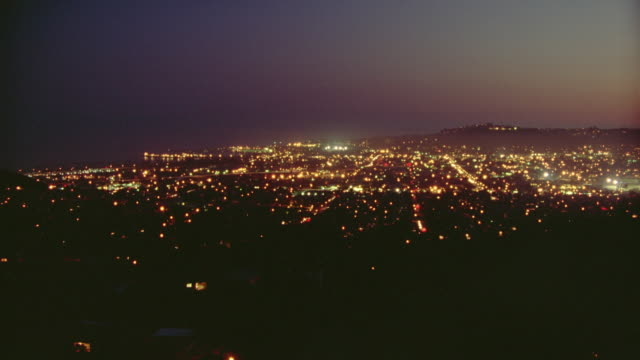 high angle wide shot of time lapse traffic and city lights at night / los angeles - wide stock videos & royalty-free footage