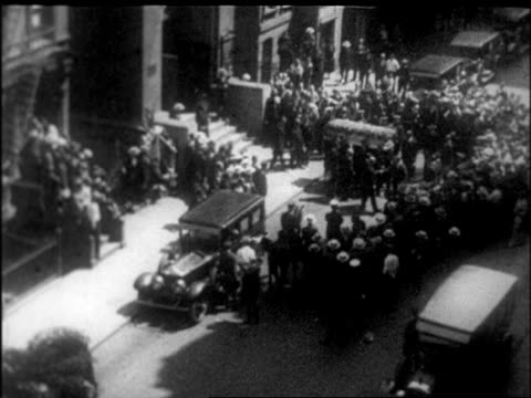b/w 1926 high angle wide shot pallbearers carrying rudolph valentino's coffin towards hearse / nyc / newsreel - 1926 stock videos & royalty-free footage