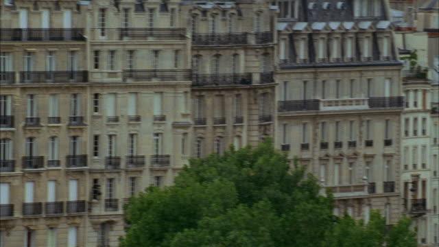 high angle wide shot pan across buildings / paris - île de france stock-videos und b-roll-filmmaterial