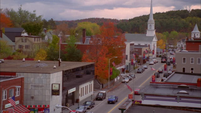 high angle wide shot pan main street in small town / autumn / new hampshire - new england usa stock videos & royalty-free footage