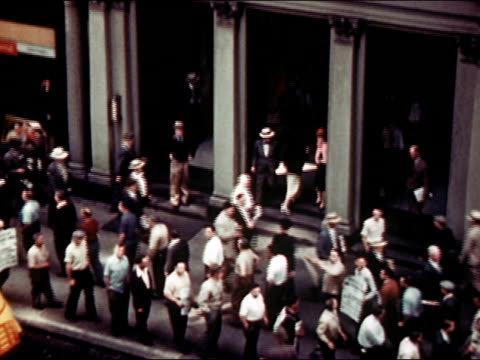 1945 high angle wide shot pan newspaper delivery workers striking on new york city sidewalk/ audio - 1945 stock videos and b-roll footage