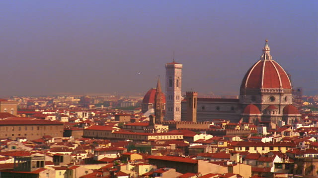 high angle wide shot pan zoom out from santa maria del fiore (duomo) and  tower to skyline of florence / italy - florence stock videos and b-roll footage