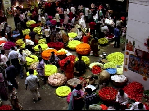 high angle wide shot panning busy flower market - bangalore stock videos and b-roll footage