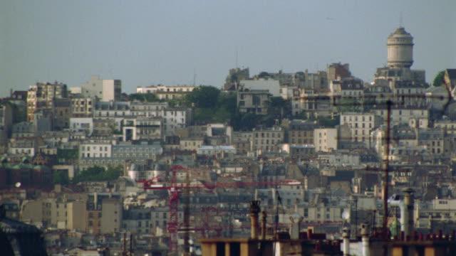high angle wide shot pan of paris to sacre coeur - basilique du sacre coeur montmartre stock videos and b-roll footage