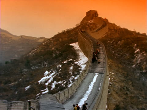 high angle wide shot people on Great Wall of China in winter / Orange filter