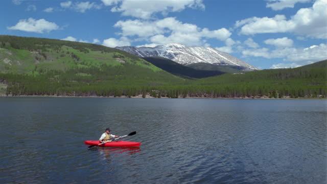 High angle wide shot person kayaking on lake/ Breckenridge, Colorado