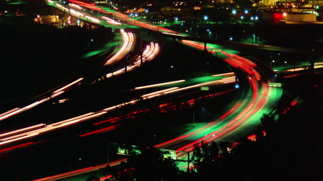 high angle wide shot rack focus time lapse traffic on highways and overpasses at night / los angeles, california - 1990 stock videos & royalty-free footage