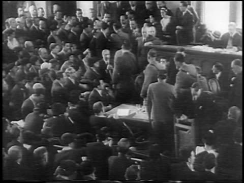 b/w 1935 high angle wide shot rear view crowd in courtroom at lindbergh kidnapping trial / nj / newsreel - 1935 stock videos & royalty-free footage