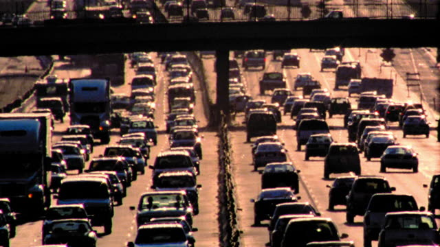 high angle wide shot rush hour traffic on highway / los angeles, california - バイパス点の映像素材/bロール