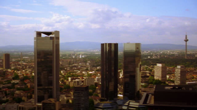 high angle wide shot pan skyscrapers (main tower, messe turm, westendstr 1, trianon, fbc, dresdner bank) /frankfurt - main tower stock videos and b-roll footage