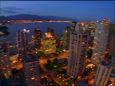 high angle wide shot pan slight fisheye time lapse vancouver cityscape with traffic / dusk to night / canada - dusk to night stock videos and b-roll footage