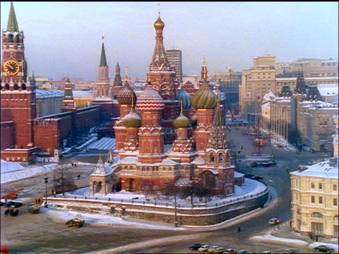 high angle wide shot St. Basil's Cathedral in Winter with Kremlin in background / Moscow
