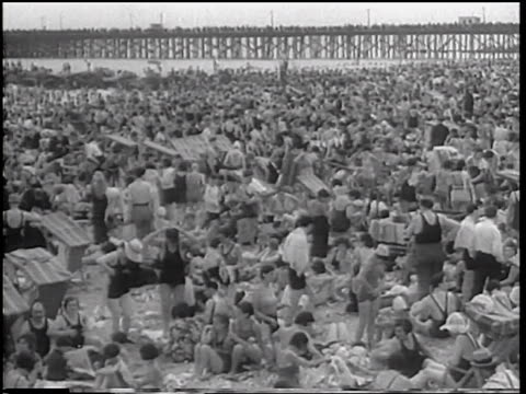 B/W 1933 high angle wide shot sunbathers in bathing suits on extremely crowded beach / Coney Island, NY