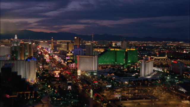 high angle wide shot the strip at twilight/ las vegas, nevada - mgm grand las vegas stock videos & royalty-free footage