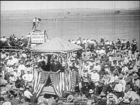 b/w 1912 high angle wide shot theodore roosevelt speaking on platform with us flags to crowd at rally / documentary - theodore roosevelt us president stock videos & royalty-free footage
