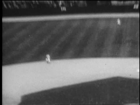 b/w 1969 high angle wide shot tilt up batter hitting ball mets player catching it / metsorioles world series - shea stadium stock videos and b-roll footage
