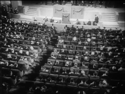view high angle wide shot tilt up crowd seated at un charter signing / sf / newsreel - 1946 stock videos and b-roll footage