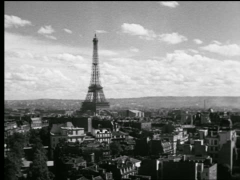 B/W 1927 high angle wide shot time lapse clouds over Paris skyline with Eiffel Tower / France