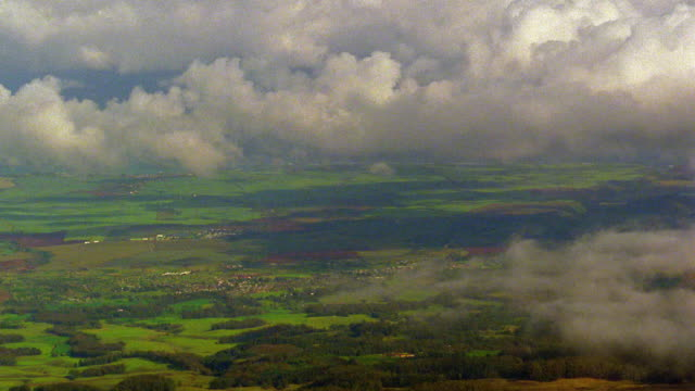 high angle wide shot time lapse clouds rolling over rural landscape / hawaii - 1985 stock videos & royalty-free footage