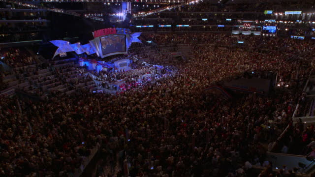 high angle wide shot time lapse democratic national convention with large crowd leaving arena after event / los angeles, ca - reporterstil stock-videos und b-roll-filmmaterial