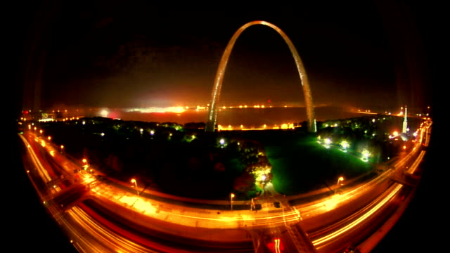 FISHEYE high angle wide shot time lapse Gateway Arch + fog covered Mississippi River at dawn / St. Louis (FLASH FRAMES)