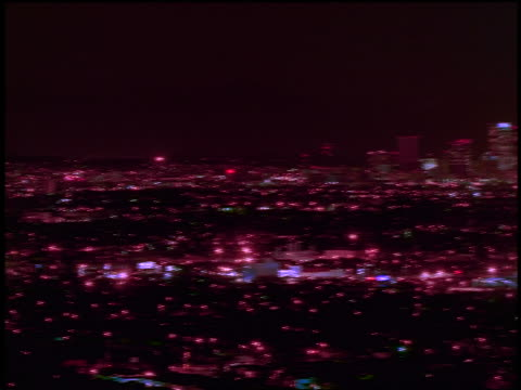 high angle wide shot PAN time lapse lights of Los Angeles at night / California
